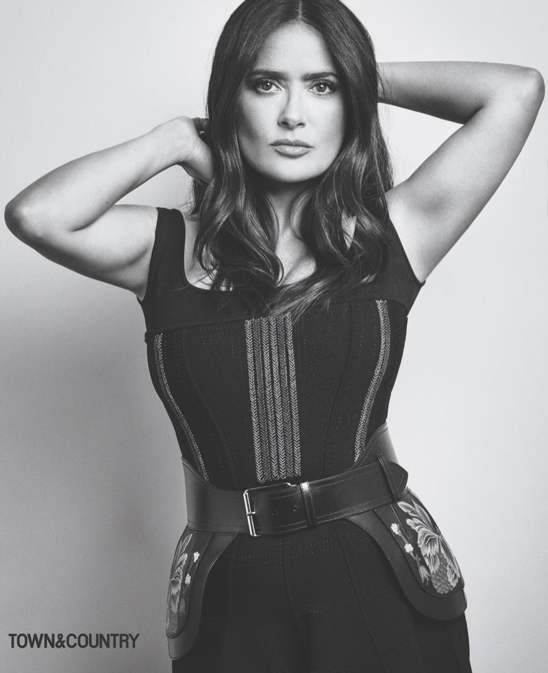 Actress Salma Hayek poses in Alexander McQueen corset dress and belt