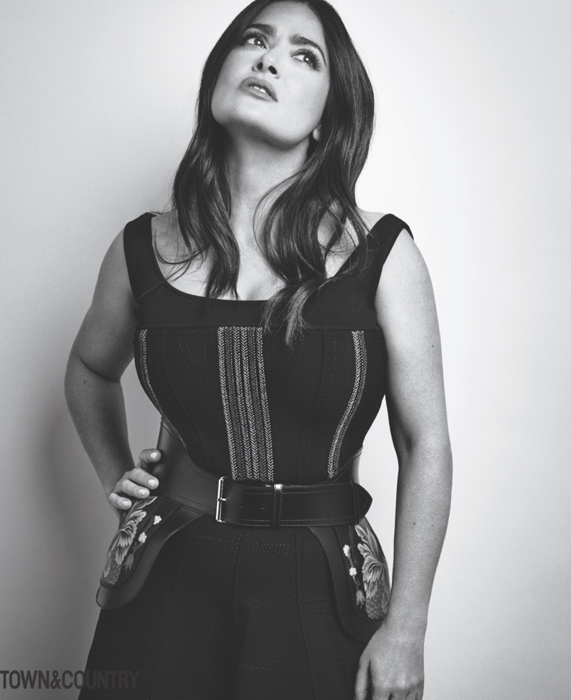 Photographed in black and white, Salma Hayek wears form-fitting look