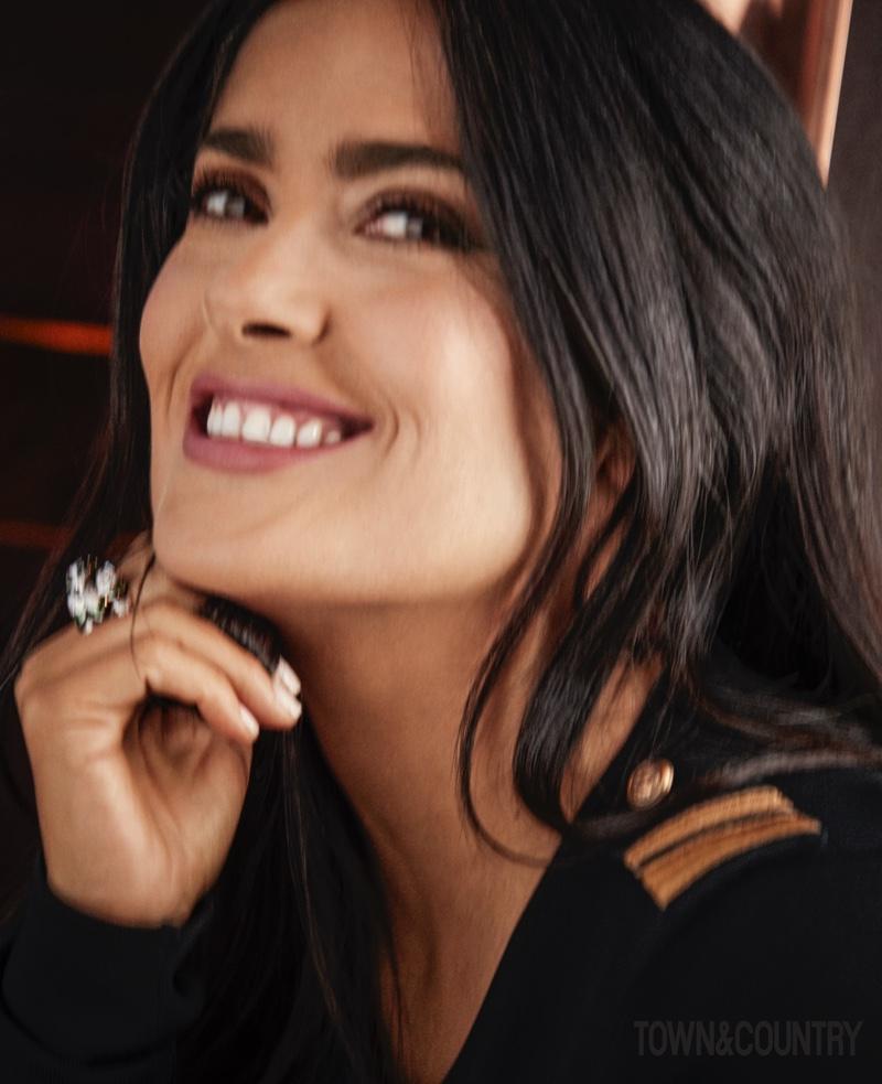 Flashing a smile, Salma Hayek wears a sparkling ring