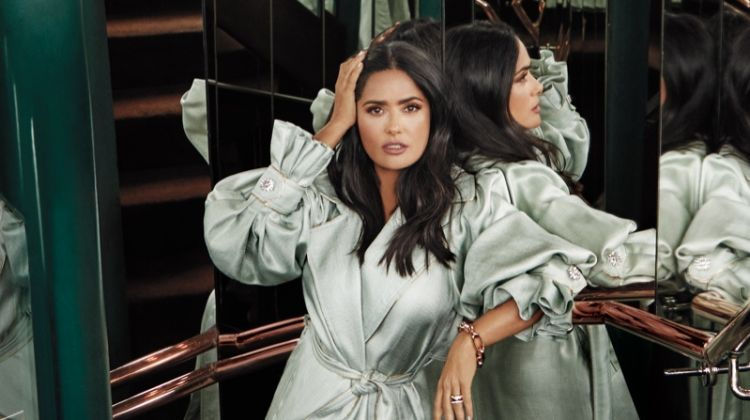 Salma Hayek poses in Peter Pilotto trench coat, Pomellato jewelry and Gucci sandals