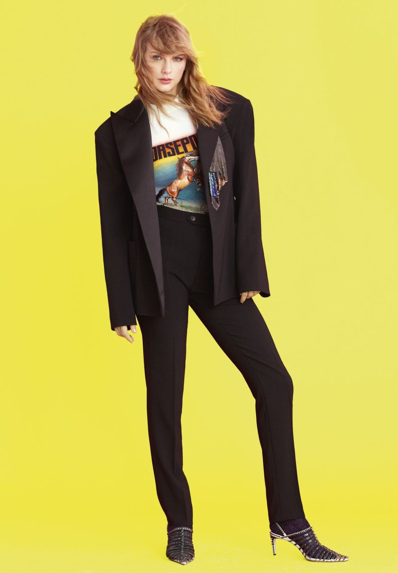 Suiting up, Taylor Swift poses in Christopher Kane jacket, top and trousers with Jimmy Choo sandals