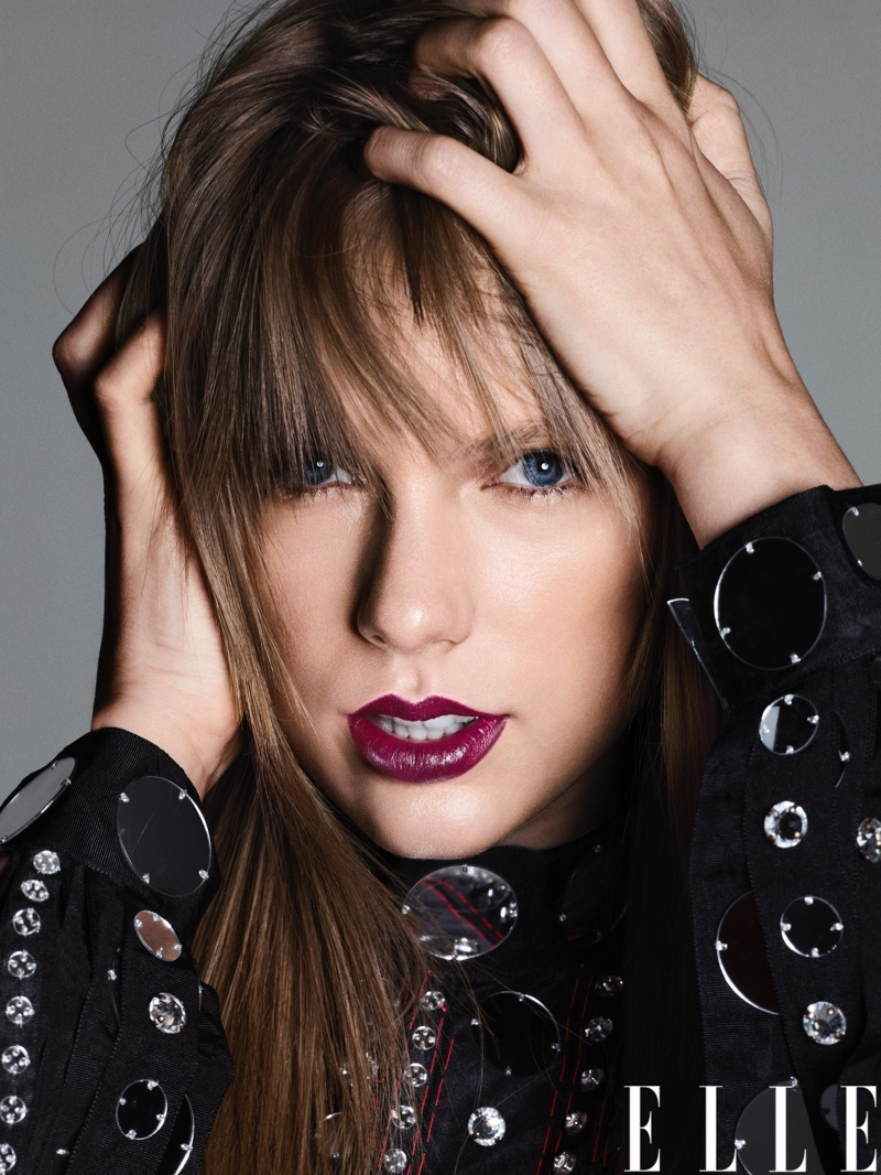 Taylor Swift poses in a Gucci embellished top