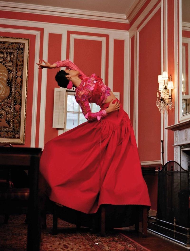 Dressed in red, Teyana Taylor wears Lou De Betoly top, Chanel skirt and Lanvin earrings