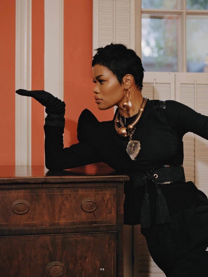 Dressed in black, Teyana Taylor wears Mugler top, Alexander Wang pants and Balmain belt
