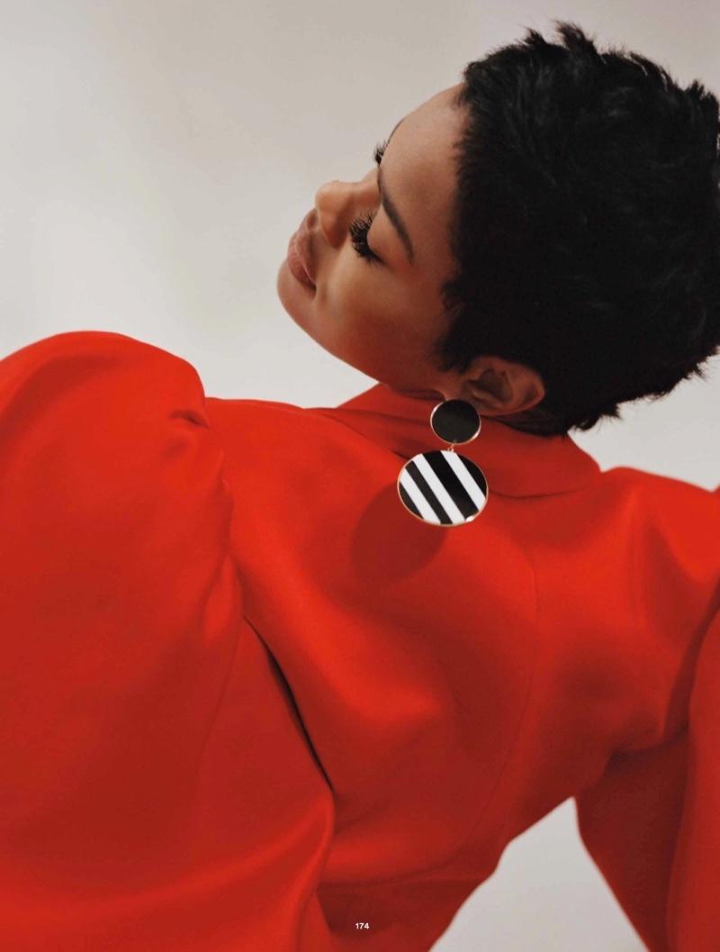 Teyana Taylor poses in Kaimin jacket and Joanna Laura Constantine earring