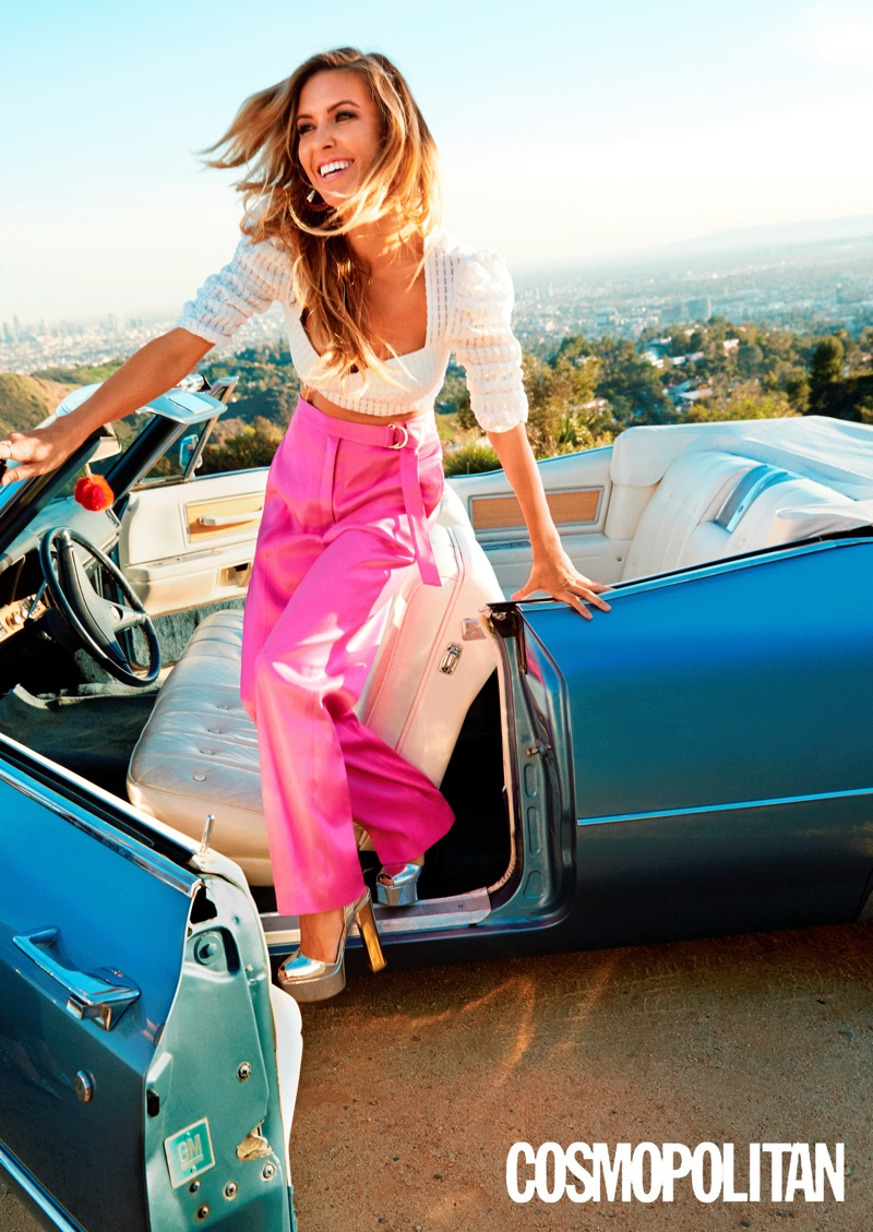 Audrina Partridge poses in a convertible car