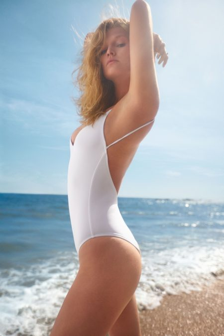 Posing in Malibu, Toni Garrn wears white swimsuit for allSisters spring-summer 2019 campaign