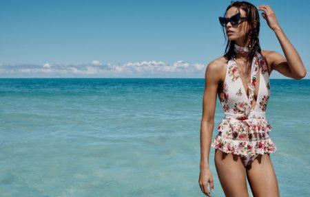 Birgit Kos wears Zimmermann Honour one piece swimsuit with ruffles
