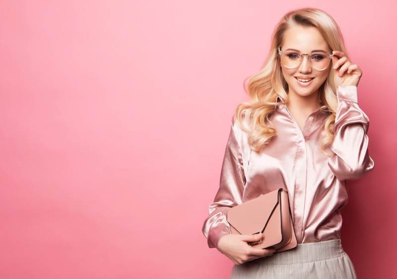 Blonde Woman in Pink Shirt Smiling with Glasses