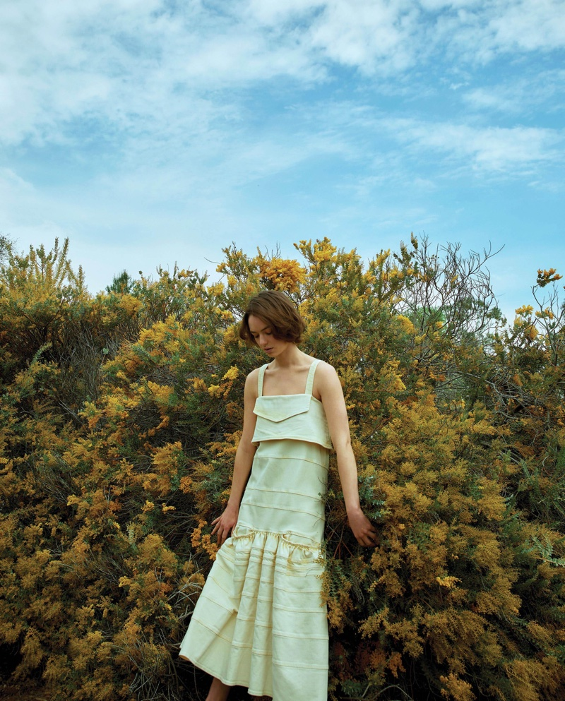 Brigette Lundy-Paine poses in yellow dress