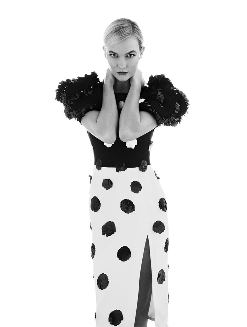 Captured in black and white, Karlie Kloss wears a Carolina Herrera design