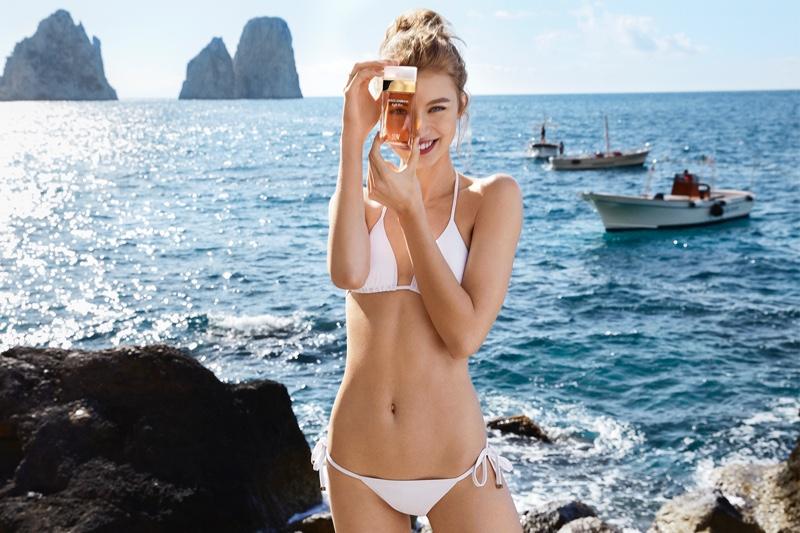 Giulia Maenza wears white bikini in Dolce & Gabbana Light Blue Sun fragrance campaign