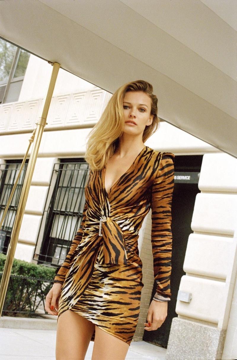 Edita Vilkeviciute poses in Alexandre Vauthier tiger print dress