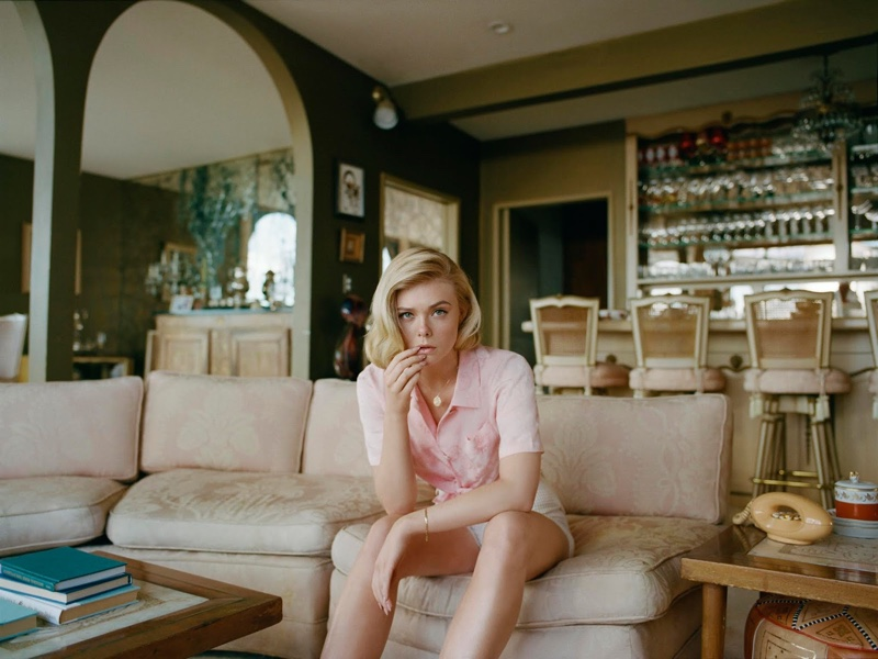 Posing on a couch, Elle Fanning wears Rejina Pyo shirt and Akris shorts