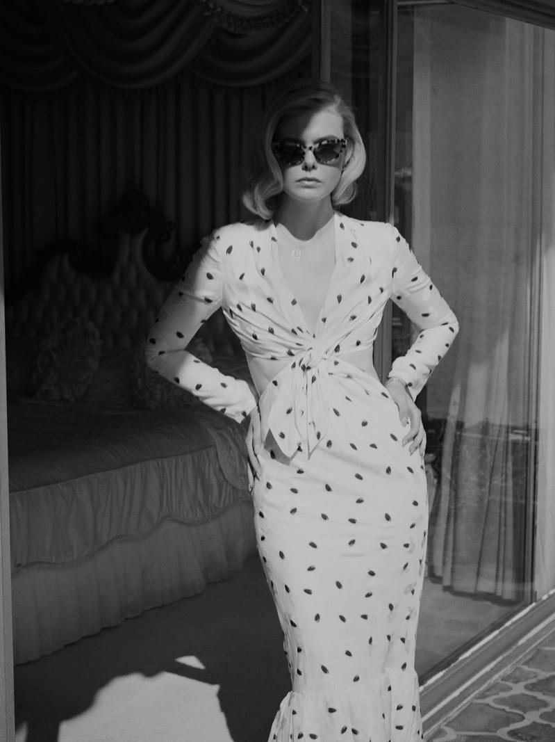 Actress Elle Fanning wears Carolina Herrera dress with Miu Miu sunglasses