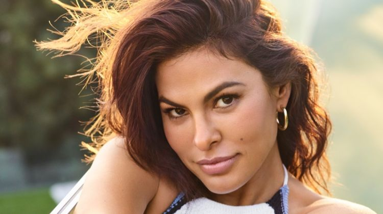 Actress Eva Mendes poses in Eva Mendes Collection at New York & Company dress with Jennifer Fisher earring
