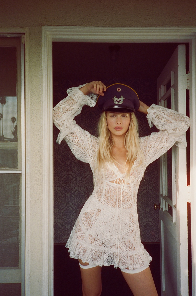 Cailin Russo poses in For Love & Lemons Sequoia lace mini dress