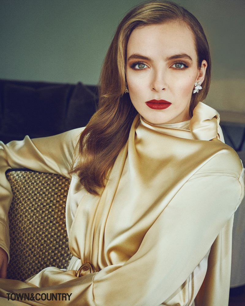 Actress Jodie Comer wears Bottega Veneta dress and Harry Winston earrings