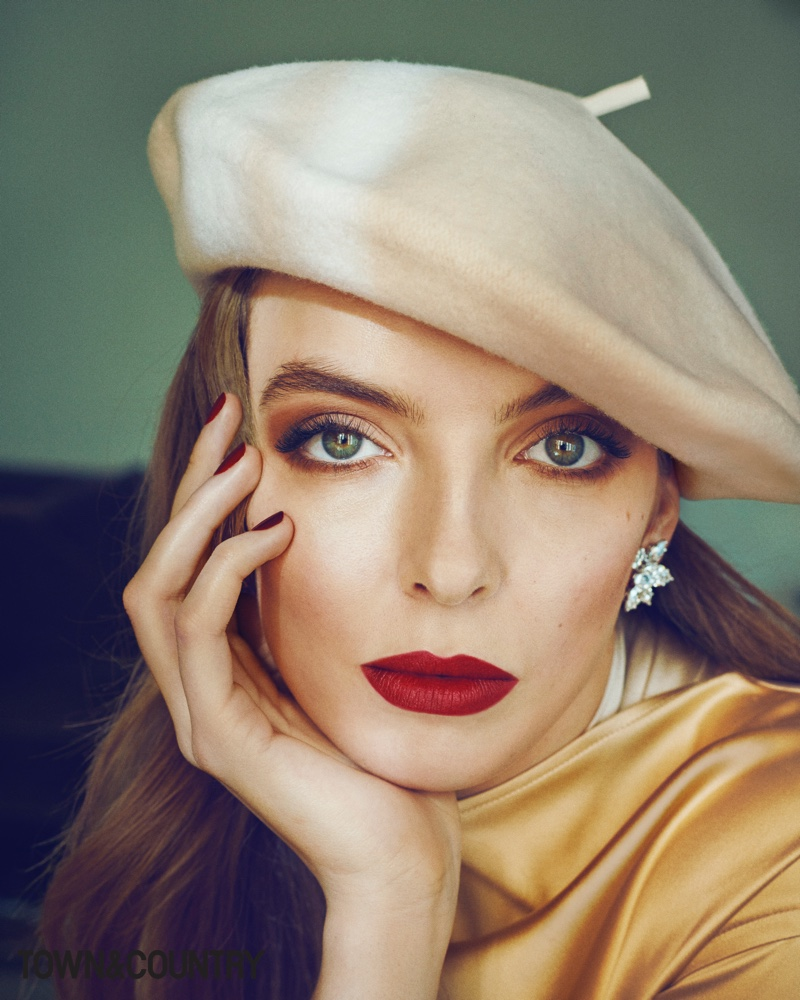 Ready for her closeup, Jodie Comer wears Bottega Veneta dress, Harry Winston earrings and Lola Hats beret