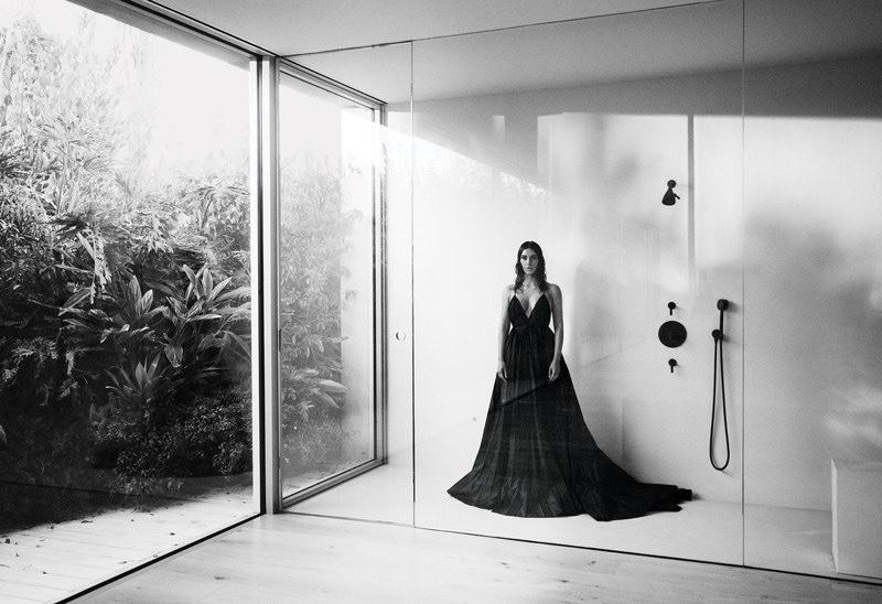 Captured in black and white, Kim Kardashian wears Valentino dress