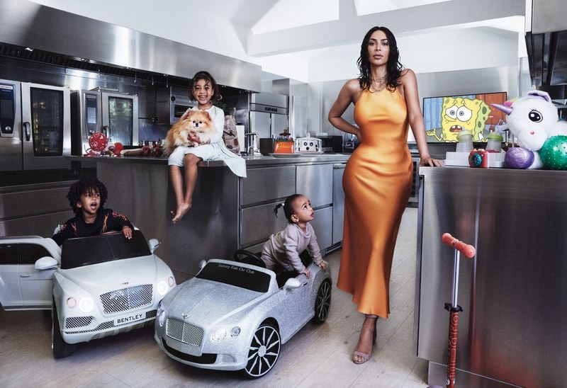 Posing with her children, Kim Kardashian models Rosetta Getty slip dress and Manolo Blahnik heels