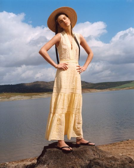 Luna Bijl poses in Mango embroidered midi dress and contrast ribbon hat