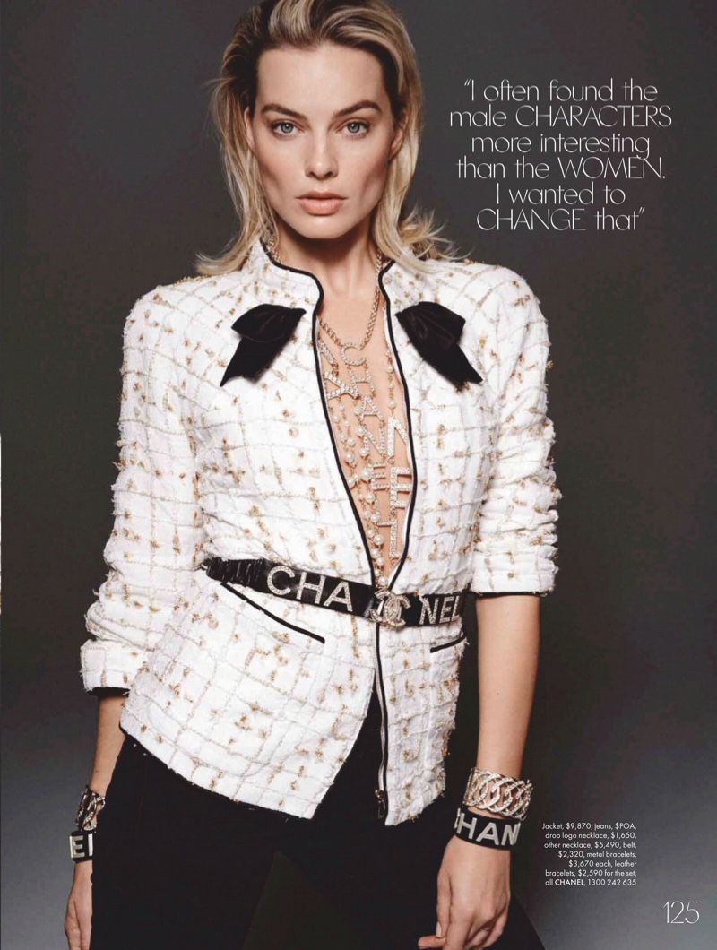 Margot Robbie poses in Chanel tweed jacket with black pants