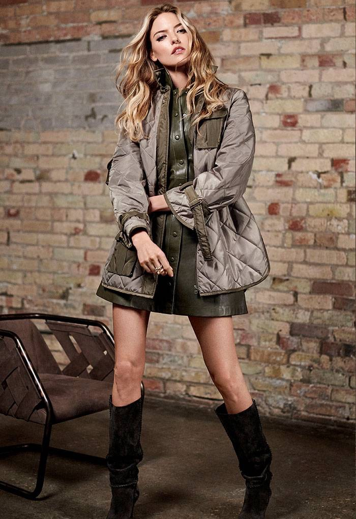 Model Martha Hunt wears Ganni jacket and leather dress with Saint Laurent boots