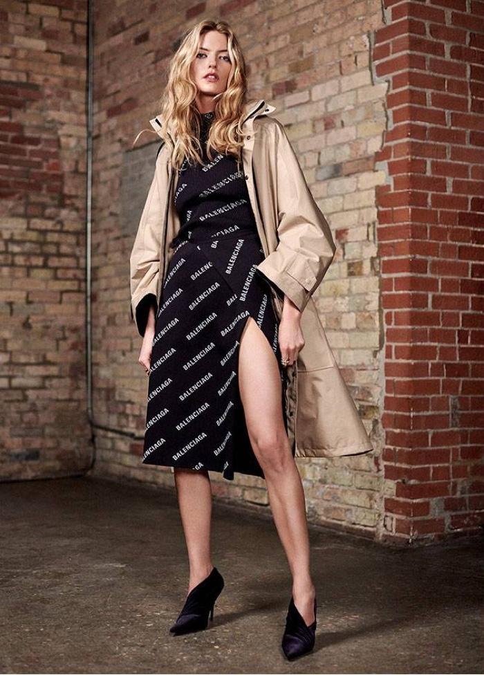 Martha Hunt poses in Balenciaga coat, logo print dress and velvet pumps