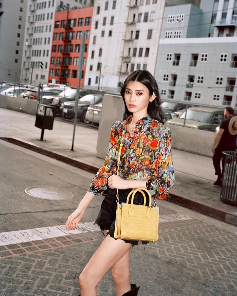 Model Ming Xi collaborates with French label The Kooples on spring 2019 handbag collection