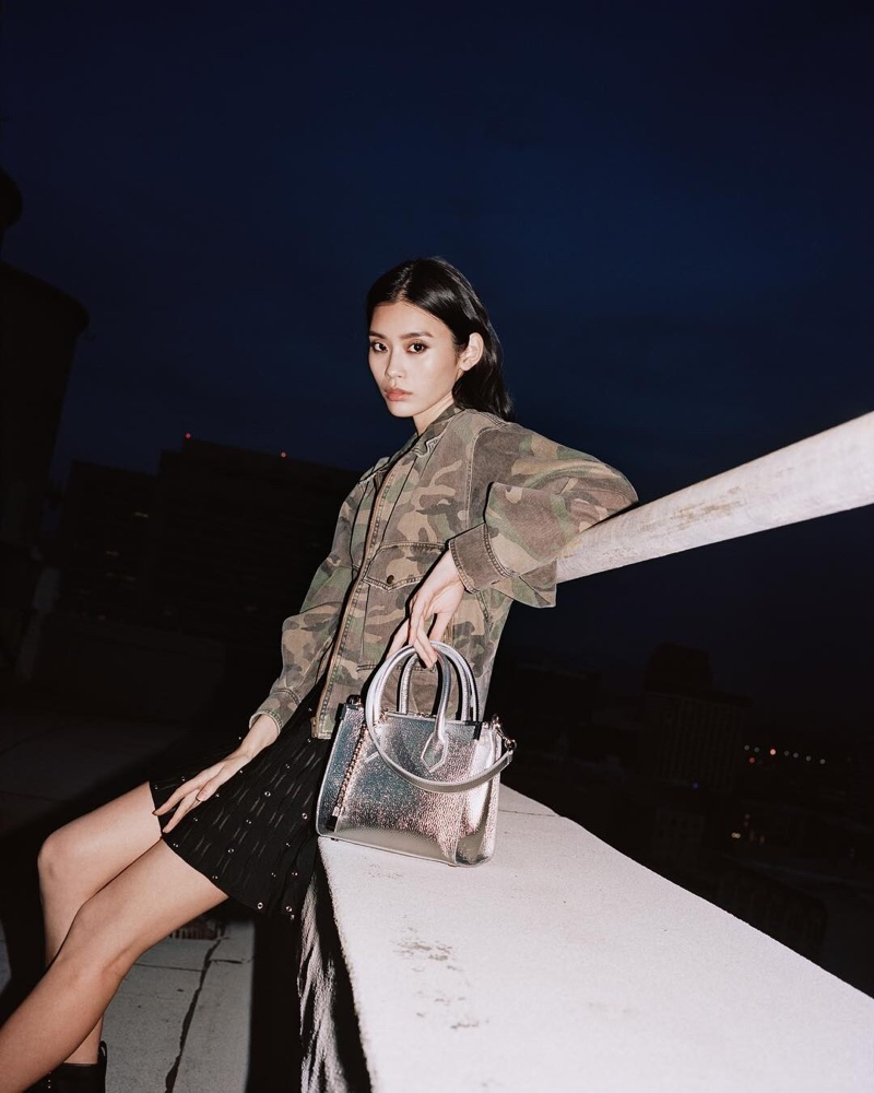 Ming Xi models Ming by The Kooples bag in silver