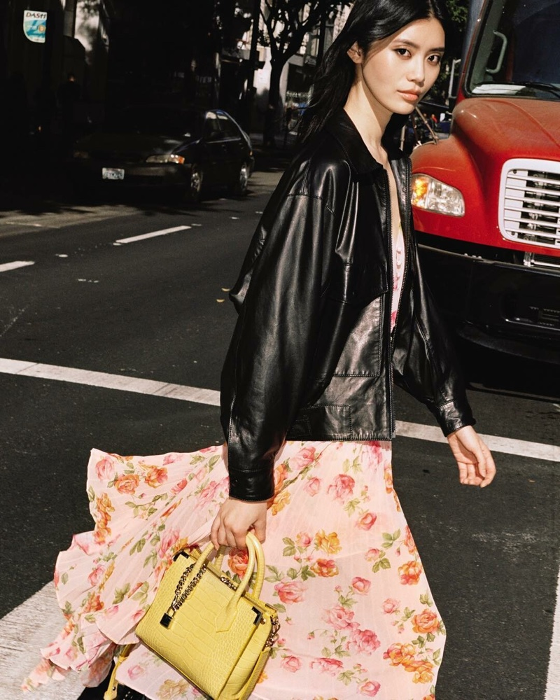Ming Xi poses with The Kooples bag collaboration in yellow