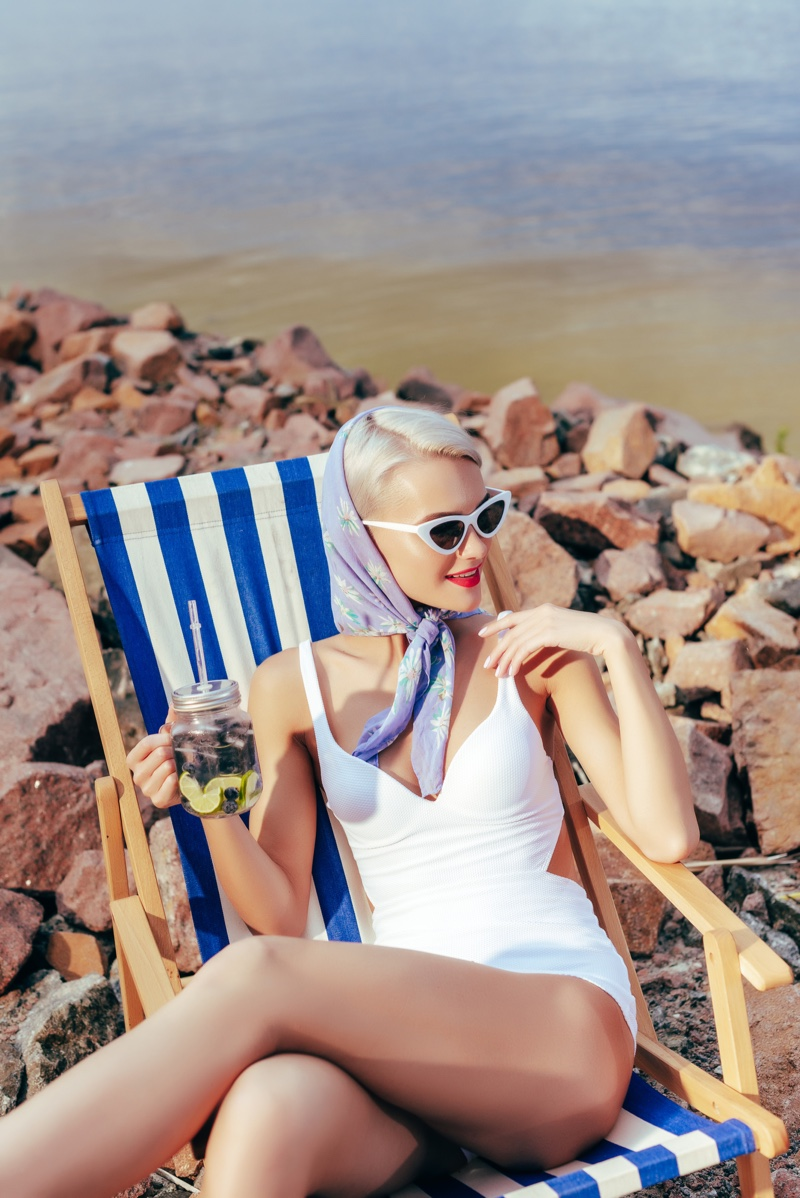 Model in White Swimsuit Wearing Scarf on the Beach