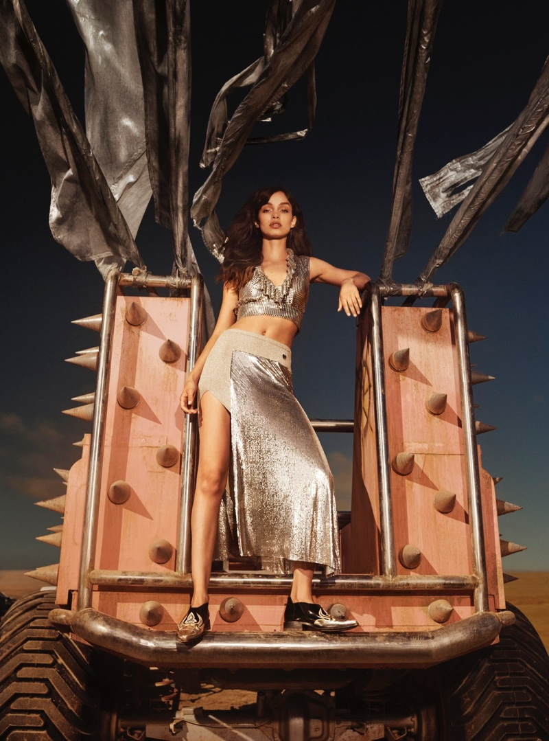 Wearing silver, Luma Grothe fronts Paco Rabanne Olympea fragrance