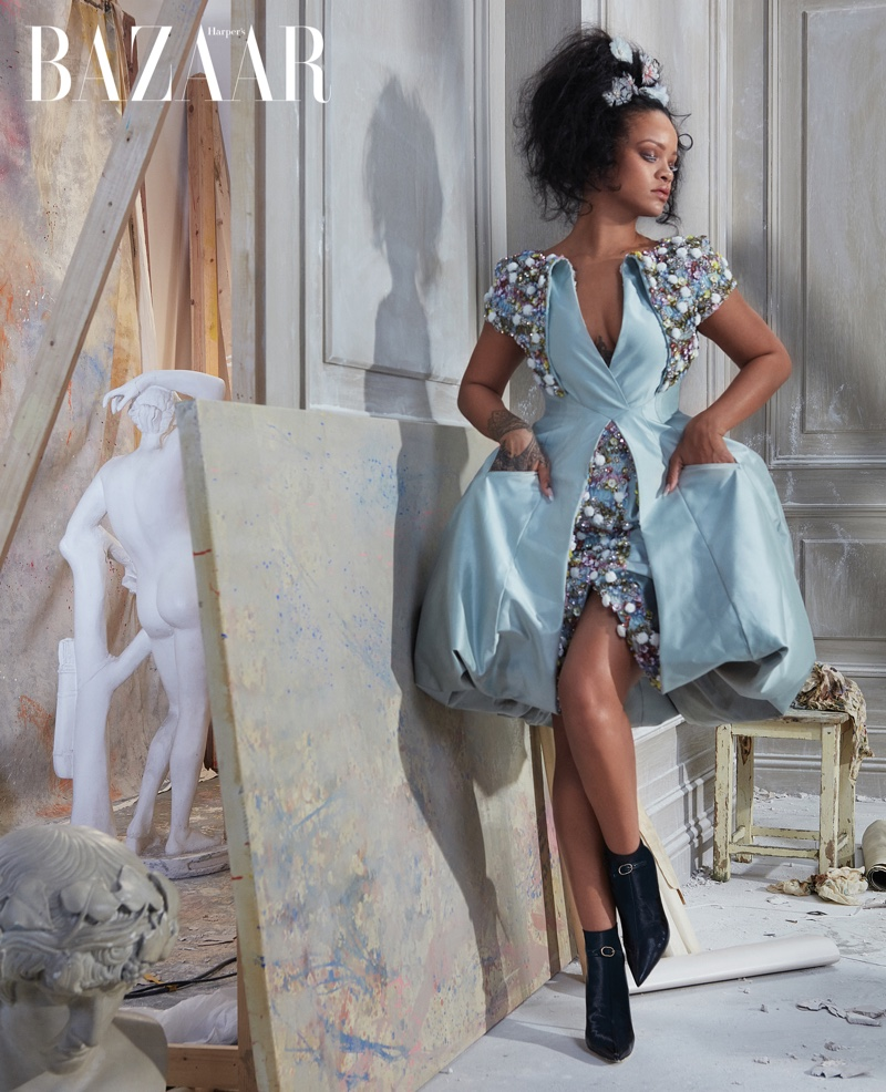 Rihanna poses in Chanel Haute Couture dress, hair accessories and boots