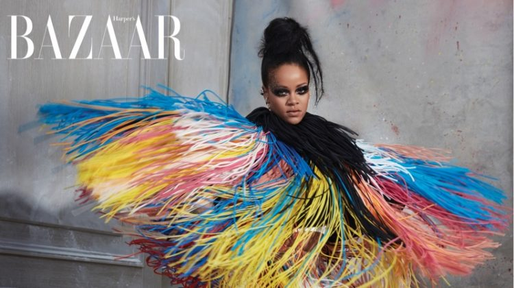 Striking a pose, Rihanna wears Givenchy Haute Couture fringed jacket, dress and shoes