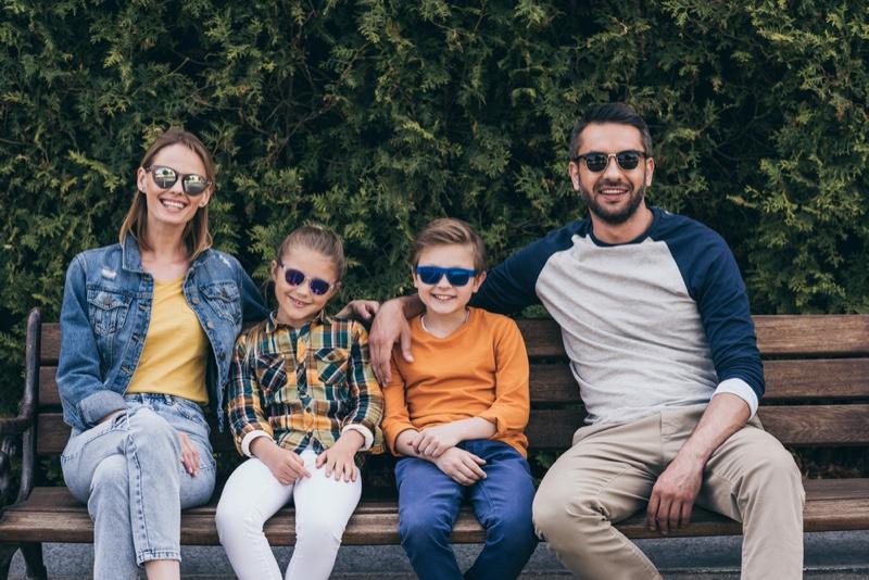 Stylish Family Mom Dad Kids Park Bench