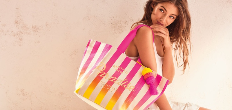 Lorena Rae poses with tote bag from Victoria's Secret