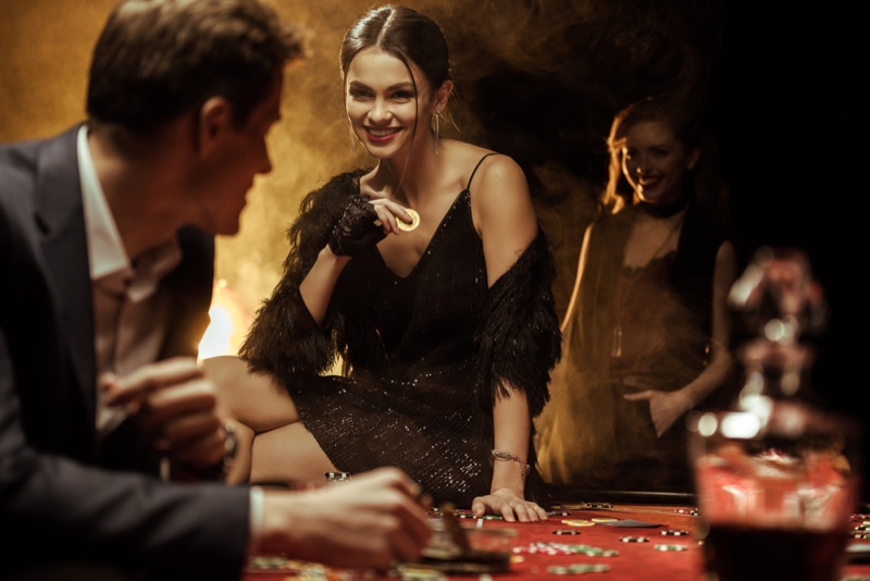 Woman in Black Sequin Dress at Casino Table
