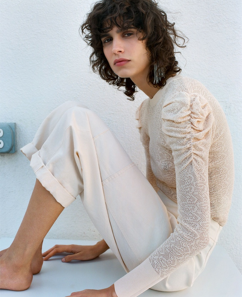 Mica Arganaraz poses in Zara limited edition ruched shoulder sweater and pants with side pockets