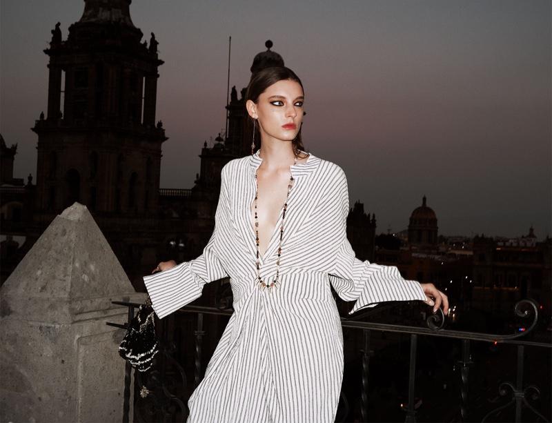 Ansley Gulielmi poses in Zara striped print dress