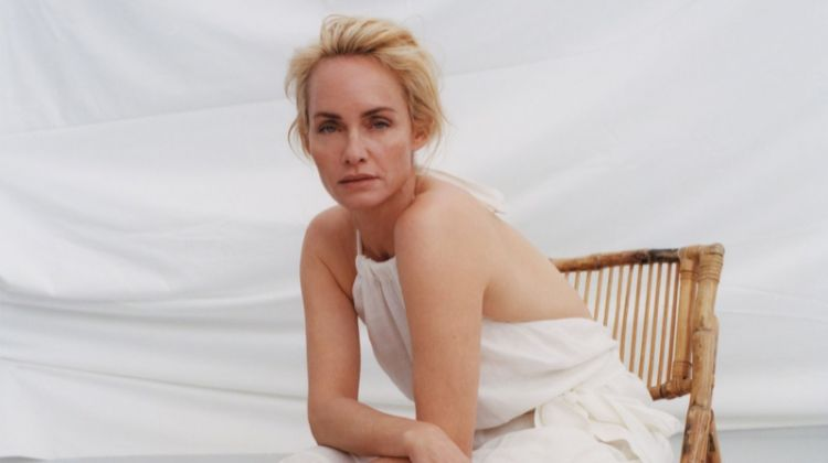Posing with oranges, Amber Valletta models white dress from Zara