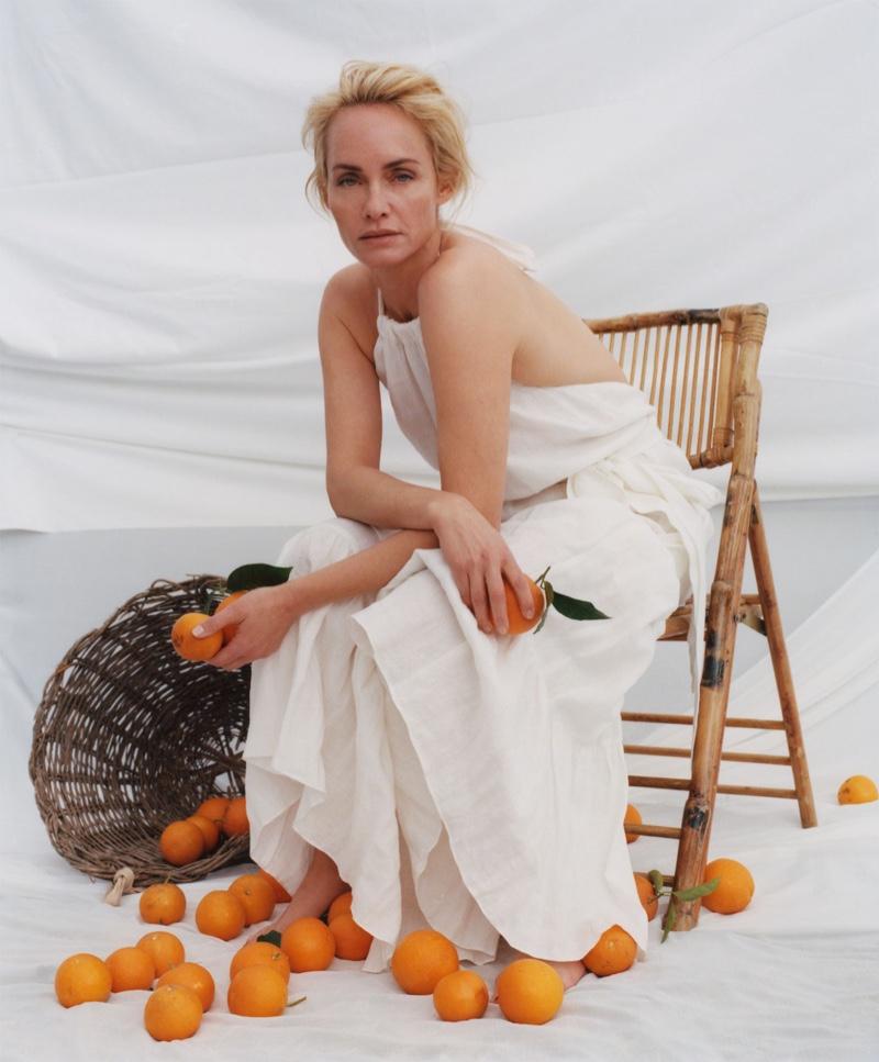 Posing with oranges, Amber Valletta models white dress from Zara