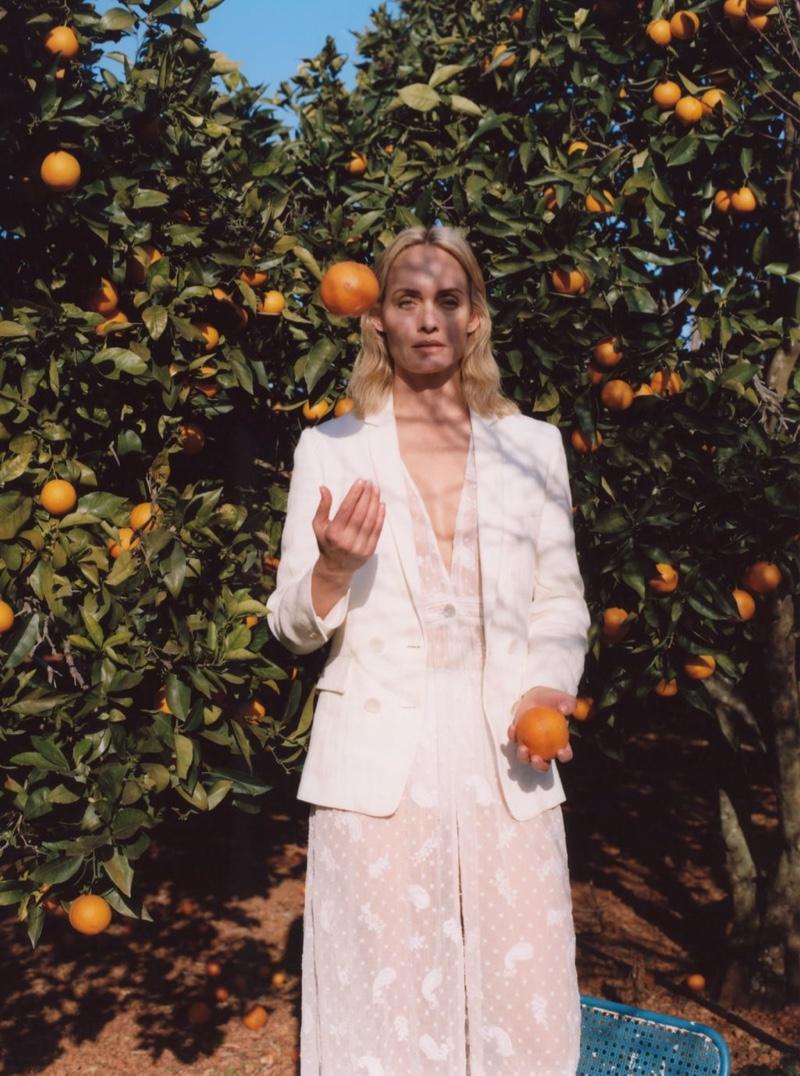 Amber Valletta Chases the Light in Zara's White Looks