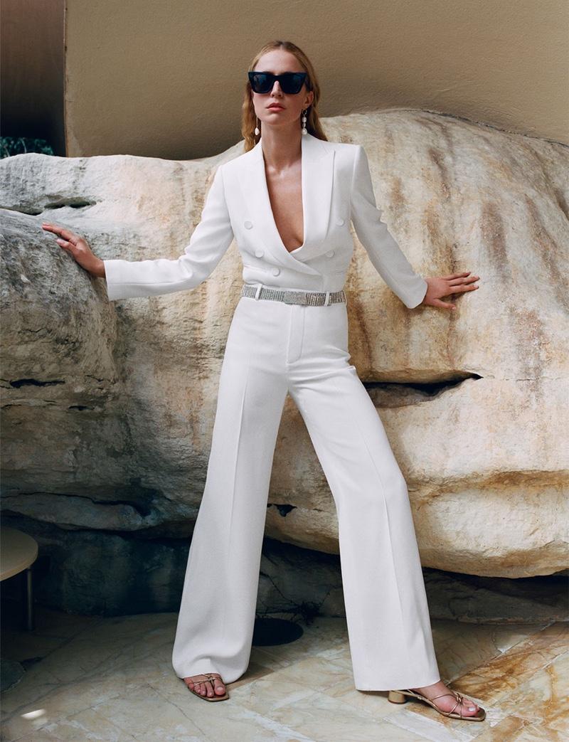 Raquel Zimmermann wears Zara tuxedo jacket, flowy wide leg pants and heeled leather sandals