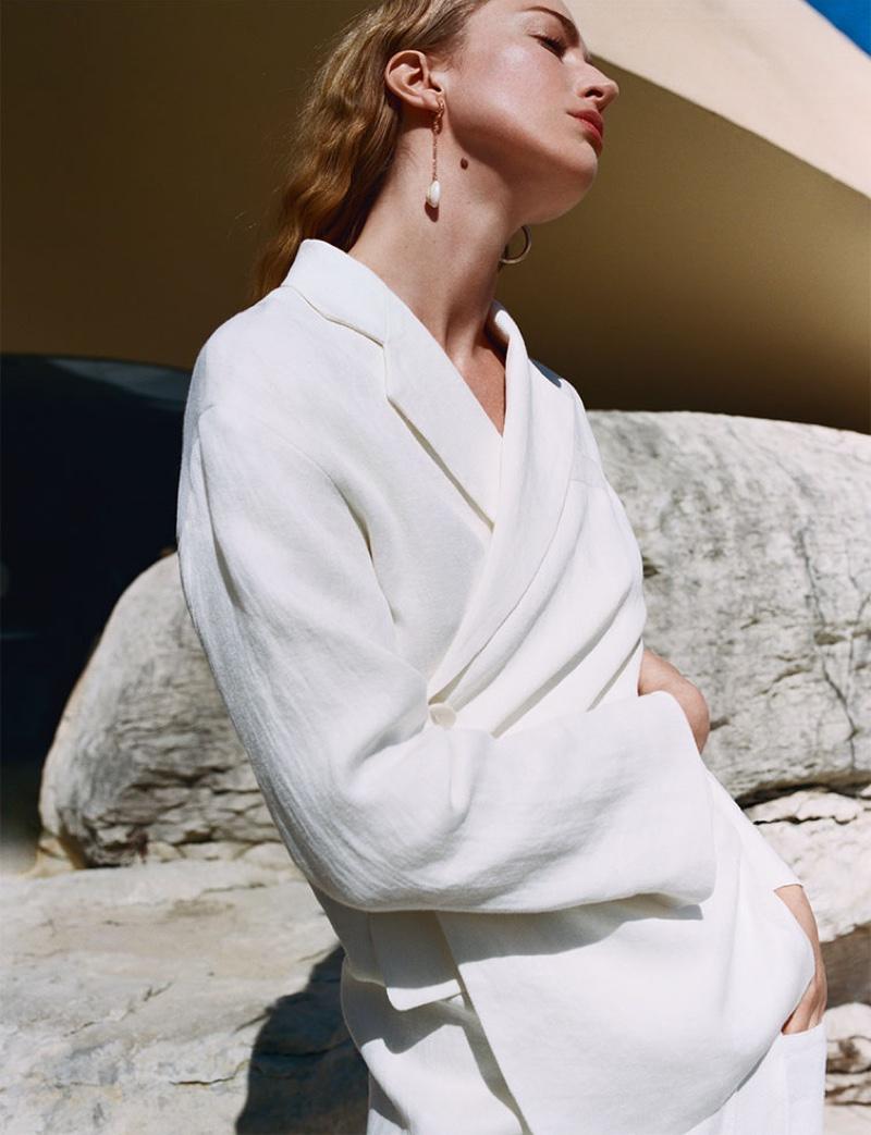 Model Raquel Zimmermann wears Zara buttoned linen blazer