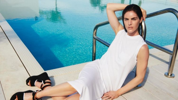 Hilary Rhoda wears a white dress in ATM summer 2019 campaign