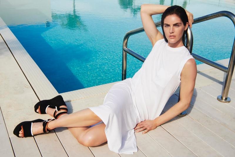 Hilary Rhoda wears a white dress in ATM summer 2019 campaign