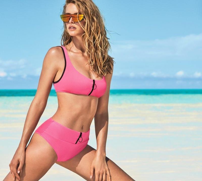 Wearing a pink bikini set, Abby Champion fronts Calzedonia Swim summer 2019 campaign