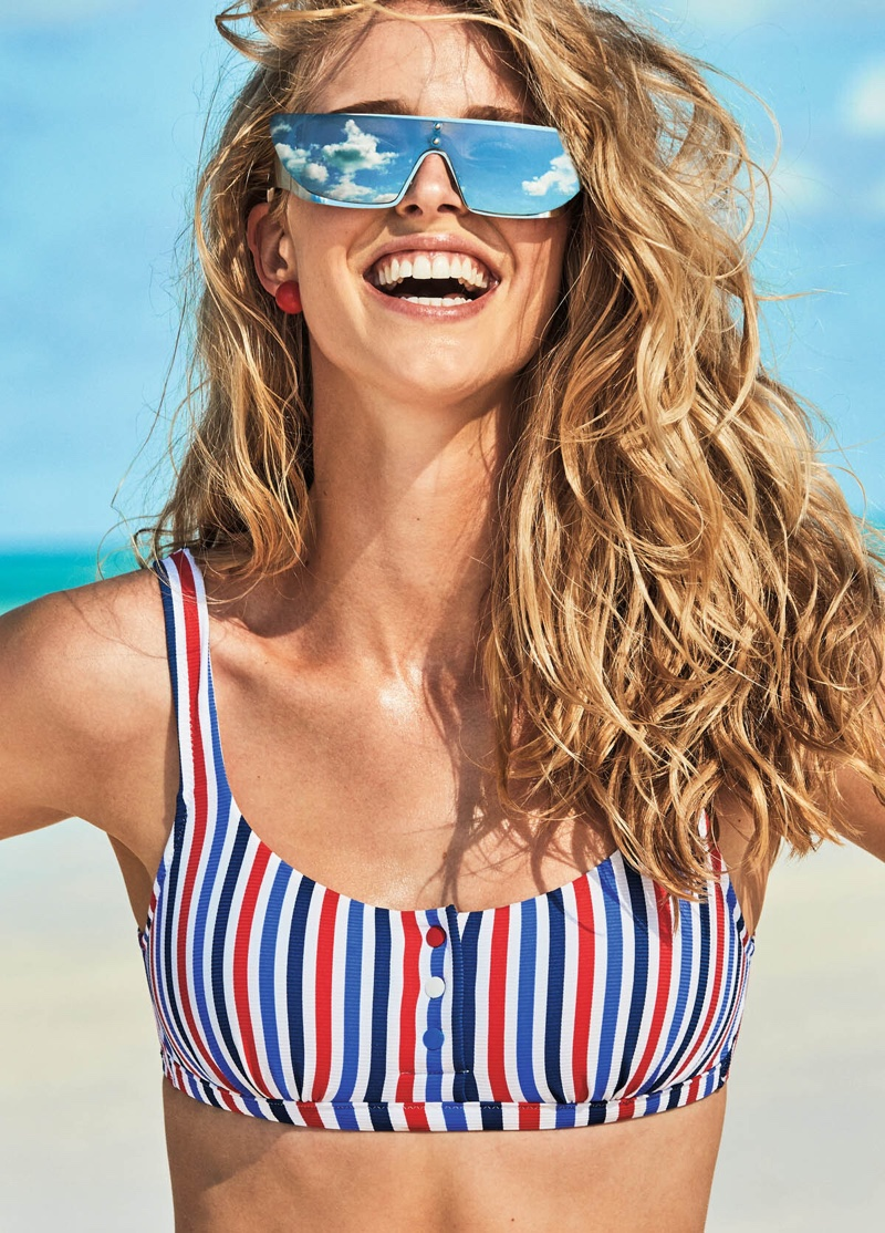 All smiles, Abby Champion poses in a striped bikini top from Calzedonia